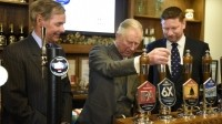 Toast: Prince Charles pulls a pint of 6X to celebrate Pub is the Hub
